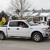 """The Hand's of Dover with their decorated truck hold signs and wave to """"Aunt Louise"""" as they drive by her house on September Drive in Greenland, NH on Wednesday during a drive-by birthday celebration for 100 year old Louise Frink Ramsdell on December 23rd 2020.  [Matt Parker/Seacoastonline]"""