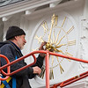 "David Graf, Historic Clock Restoration Expert puts the finishing touches on the newly installed and extremely unique and ornate 36"" clock face that graces the central courtyard of the Carey Cottage on Wednesday 12-30-2020, Portsmouth, NH.  [Matt Parker/Seacoastonling]"