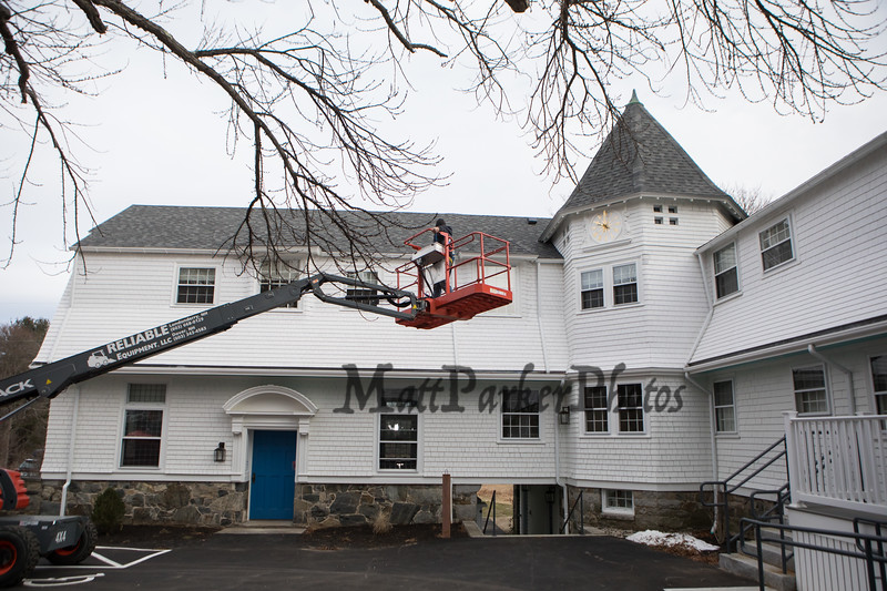 "David Graf, Historic Clock Restoration Expert puts the finishing touches on the newly installed and extremely unique and ornate 36"" clock face that graces the central courtyard of the Carey Cottage on Wednesday 12-30-2020, Portsmouth, NH.  Matt Parker Photos"