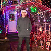 Hunter Lawson stands in the lighted tunnel as  extensive Christmas lights and Christmas themes fill the yard of 18 year old Hunter Lawson and his Grandfather Chuck where their yearly lighting display honors his late mother/daughter Shelly.  12-9-2020, Hampton Beach, NH.  Matt Parker Photos