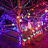 Extensive Christmas lights and Christmas themes fill the yard of 18 year old Hunter Lawson and his Grandfather Chuck where their yearly lighting display honors his late mother/daughter Shelly.  12-9-2020, Hampton Beach, NH.  Matt Parker Photos