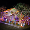 Hunter Lawson stands in front of his extensive Christmas lights and Christmas themes as they fill the yard of 18 year old Hunter Lawson and his Grandfather Chuck where their yearly lighting display honors his late mother/daughter Shelly.  12-9-2020, Hampton Beach, NH.  Matt Parker Photos
