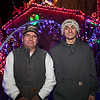 Hunter Lawson (R) with his Grandfather Chuck pose for a photo in front of their lighting display.  Extensive Christmas lights and Christmas themes fill the yard of 18 year old Hunter Lawson and his Grandfather Chuck where their yearly lighting display honors his late mother/daughter Shelly.  12-9-2020, Hampton Beach, NH.  Matt Parker Photos