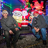 Hunter Lawson (L) with his Godfather Desi Lanio sitting in front of a santa with minions.  Extensive Christmas lights and Christmas themes fill the yard of 18 year old Hunter Lawson and his Grandfather Chuck where their yearly lighting display honors his late mother/daughter Shelly.  12-9-2020, Hampton Beach, NH.  Matt Parker Photos