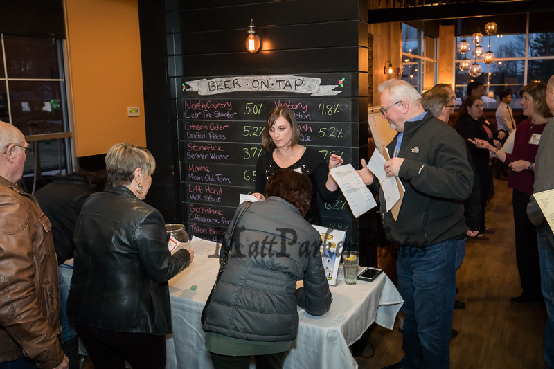Board Member Kirsten Larsen-Schultz checking in the guest at the North Hampton Business Association Annual Meeting, Tuesday, February 4, 2020 at the Barley House Restaurant, North Hampton, NH.  Matt Parker Photos