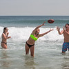 Londonderry's Lilly Bowman (L) and Julia Cole with a friend playing football in the waves at Hampton Beach's opening weekend on Saturday June 6th 2020.  Matt Parker Photos
