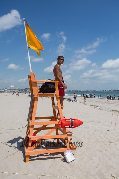 2nd year Hampton Beach Lifeguard Jordan Ramos keeping an eye on a relatively quite beach at Hampton Beach's opening weekend on Saturday June 6th 2020.  [Matt Parker/Seacoastonline]