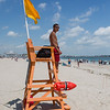 2nd year Hampton Beach Lifeguard Jordan Ramos keeping an eye on a relatively quite beach at Hampton Beach's opening weekend on Saturday June 6th 2020.  [Matt Parker/Seacoastonline]