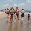 Londonderry's Lilly Bowman (L) and Julia Cole running in the surf at Hampton Beach's opening weekend on Saturday June 6th 2020.  Matt Parker Photos