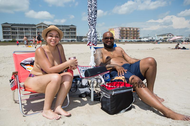 Yahaira Rivera and Pedro Rodriguez of Manchester CT enjoying Hampton Beach's opening weekend on Saturday June 6th 2020.  [Matt Parker/Seacoastonline]