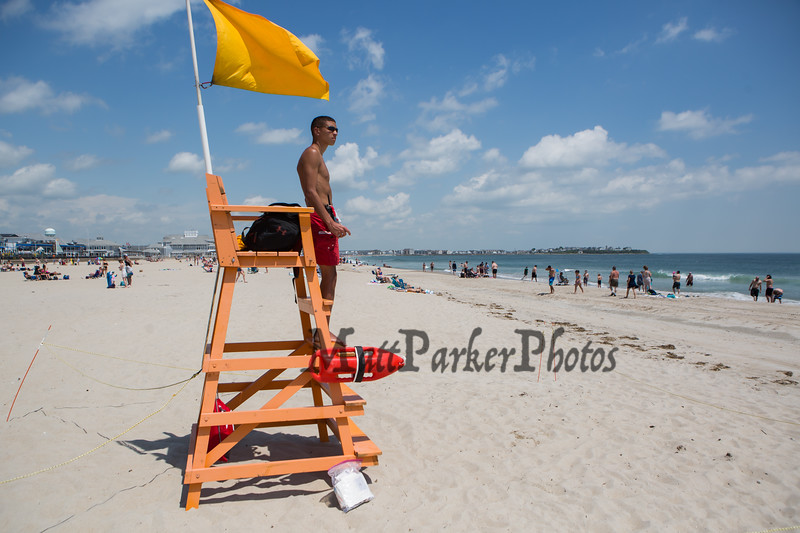 2nd year Hampton Beach Lifeguard Jordan Ramos keeping an eye on a relatively quite beach at Hampton Beach's opening weekend on Saturday June 6th 2020.  Matt Parker Photos
