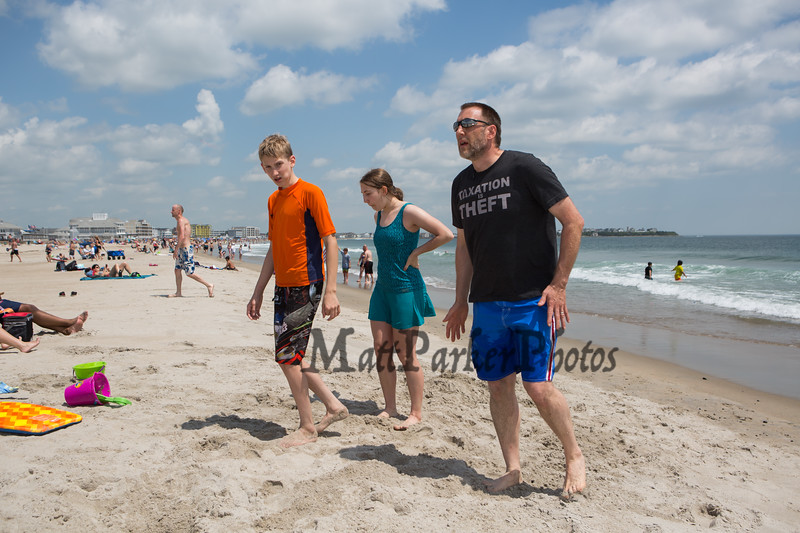 JR Hoell of Dunbarton with his kids 10th grader Sarah and 7th grader Benjamin pose for a photo on opening weekend at Hampton Beach, JR is a founding member of Re-open NH on Saturday June 6th 2020.  Matt Parker Photos