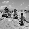 A young family from Glenn Falls NY bury their father in the sand while enjoying Hampton Beach's opening weekend on Saturday June 6th 2020.  Matt Parker Photos