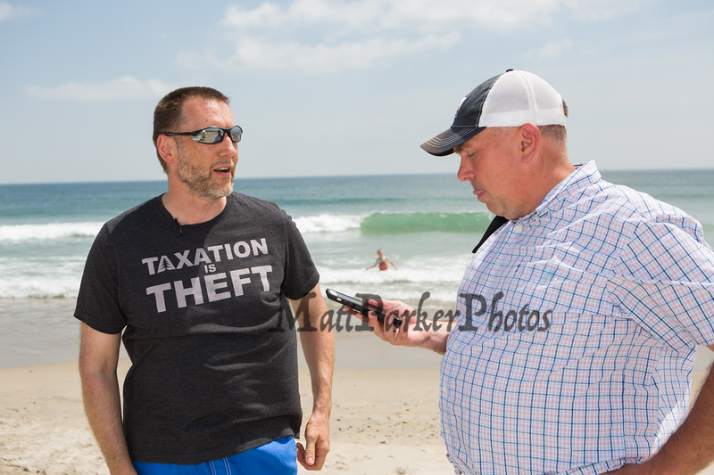 Reporter Jay Pinsonnault interviews JR Hoell of Dunbarton NH a member of Re-Open NH at Hampton Beach's opening weekend and Re-Open NH rally on Saturday June 6th 2020.  Matt Parker Photos