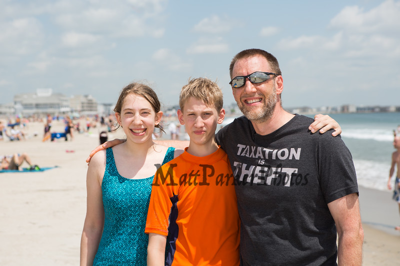 JR Hoell of Dunbarton with his kids 10th grader Sarah and 7th grader Benjamin pose for a photo on opening weekend at Hampton Beach, JR is a founding member of Re-open NH on Saturday June 6th 2020.  [Matt Parker/Seacoastonline]