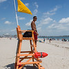2nd year Hampton Beach Lifeguard Jordan Ramos keeping an eye on a relatively quite beach at Hampton Beach's opening weekend on Saturday June 6th 2020.  Matt Parker Photos