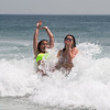 Londonderry's Lilly Bowman (L) and Julia Cole enjoying the water and waves at Hampton Beach's opening weekend on Saturday June 6th 2020.  [Matt Parker/Seacoastonline]
