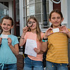 The Little Detictives Co. (L to R) 10 year olds and 5th graders at Newfields Elementary School, Maya Lynch, Kate Johnson and Hannah Lynch (not present and 4th detective Robinson Cartmell) show off their business cards and web address during an interview regarding their new detective business on Monday 9-28-2020 @ Newfields General Store.  [Matt Parker/Seacoastonline]