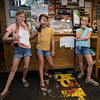 The Little Detictives Co. (L to R) 10 year olds and 5th graders at Newfields Elementary School, Kate Johnson, Hannah Lynch and twin sister Maya Lynch pose for a photo next to their advertisement with pull strips inside of the Newfields General Store during an interview regarding their new detective business on Monday 9-28-2020 @ Newfields NH.  [Matt Parker/Seacoastonline]