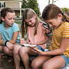 The Little Detictives Co. (L to R) 10 year olds and 5th graders at Newfields Elementary School, Maya Lynch, Kate Johnson and Hannah Lynch (not present and 4th detective Robinson Cartmell) during an interview regarding their detective business on Monday 9-28-2020 @ Newfields General Store.  [Matt Parker/Seacoastonline]