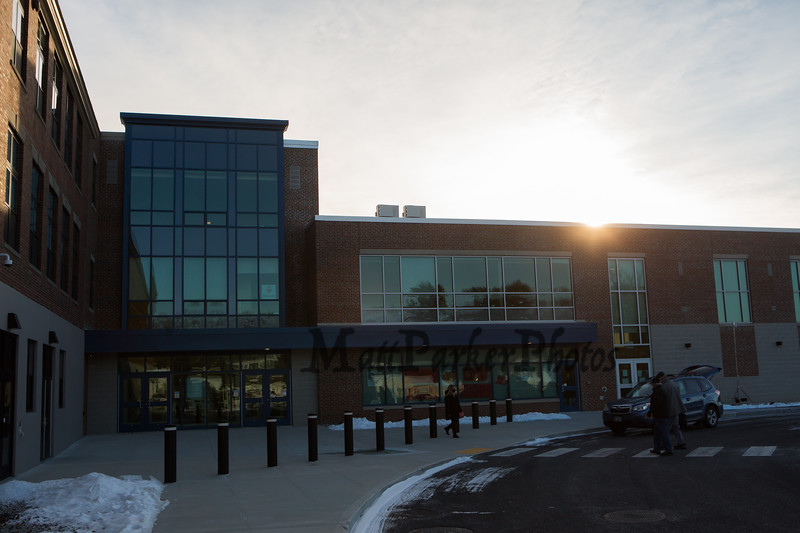 The sun rises over Hampton Academy as Hampton citizens make their way to the new gym at Hampton Academy as The Town of Hampton holds it's 1st deliberative session of the 2021 Annual Town Meeting on Saturday January 30th at Hampton Academy, Hampton NH.  Matt Parker Photos