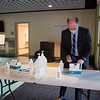 Town Moderator Robert Casassa prepares the sanitizing station at the entrance to the school gym as The Town of Hampton holds it's 1st deliberative session of the 2021 Annual Town Meeting on Saturday January 30th at Hampton Academy, Hampton NH.  Matt Parker Photos