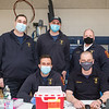 First Responders from North Hampton Fire and Rescue pose for a photo during a break from administering COVID-19 vaccines, Stephen Milata, Will Taber, Luke Denio, Eric Clouthier,  and Mark Cook at Winnacunnet High School, Hampton NH on Saturday March 20th, 2021.  Matt Parker Photos