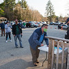 """Brentwood residents sign in at an outside table as Officer Gagnon assists as Brentwood Selectmen hold a public meeting on whether to continue funding the Brentwood Newsletter after public outcry from a March editorial titled, """"Racism: From a White Man's Perspective."""" authored by Richard Gagnon which some say was """"racist"""", op-ed, on Tuesday April 20th, 20219, Brentwood Recreational Building, Brentwood NH.  [Matt Parker/Seacoastonline]"""