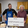 """Joan Sweeney (r) a St. Vincent de Paul volunteer introduces Chef Ben St Jeanne of The Big Bad Food Truck where he will showcase his technique for, """"Breaking down a Chicken for Cooking and Serving""""during a Facebook Live event held at the new SVdP's Community Kitchen.  SVdP of Hampton is holding a series of Cooking Shows featuring local chefs as a promotion for their fundraising campaign to cover the costs of their new building on Wednesday 5-5-2021, 441R, Lafayette Road, Hampton NH.  [Matt Parker Seacoastonline]"""