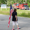 Members of the Arkell family, police officers, government officials and local community hold a ceremony at Swasey Central School for the dedicating the Brentwood portion of Route 125 as Officer Stephen Arkell Memorial Highway on Saturday July 10th, 2021, Brentwood NH.  Matt Parker Photos