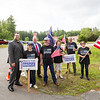 """Robin Wrighton (2nd from left) with police supports hold signs, """"Back The Badge"""", Members of the Arkell family, police officers, government officials and local community hold a ceremony at Swasey Central School for the dedicating the Brentwood portion of Route 125 as Officer Stephen Arkell Memorial Highway on Saturday July 10th, 2021, Brentwood NH.  Matt Parker Photos"""