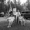"""""""Defend Not Defund"""" police supporters (L to R) Lilli Walsh of Hampstead, Pam Brown of Kingston and Jorge Mesa-Tejada of Hampstead raise their flags.  Members of the Arkell family, police officers, government officials and local community hold a ceremony at Swasey Central School for the dedicating the Brentwood portion of Route 125 as Officer Stephen Arkell Memorial Highway on Saturday July 10th, 2021, Brentwood NH.  Matt Parker Photos"""