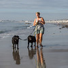 Johanna Chawziuk and her dogs Vilote and Duncan take a walk on Hampton's North Beach at low tide on on Saturday 8-21-2021.  Matt Parker Photos