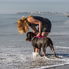 """Tracey Corbit of Hampton and her Wire Hair Pointer """"Griffon"""" play in the water on Saturday Morning at Hampton North Beach on 8-21-2021.  Matt Parker Photos"""