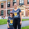 Jess Austin and her Centre School 2nd grader Evan, who was diagnosed with Diffuse intrinsic pontine glioma (DIPG) pose for a photo in front of the Hampton Academy where bags with candles were placed in support of ending childhood cancer.  The planned event, Light Up the Night To End Childhood Cancer, included the placement of candles around schools and surrounding areas of Hampton on Saturday night 9-25-2021.  Matt Parker Photos
