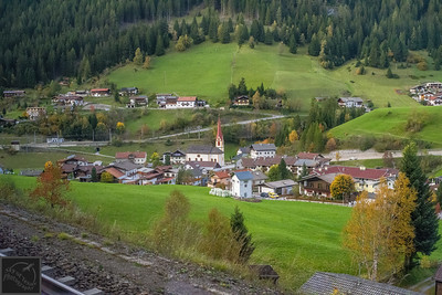 Village in the south Tyrol Alps viewed from train.