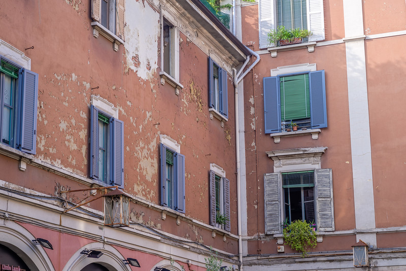 Building a little decrepit looking? Just add some (more) freshly painted shutters. Not everyone got the memo, though.