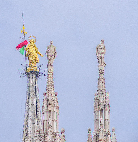 Golden statue of the Madonna on one of the 135 spires of the Duomo di Milano.