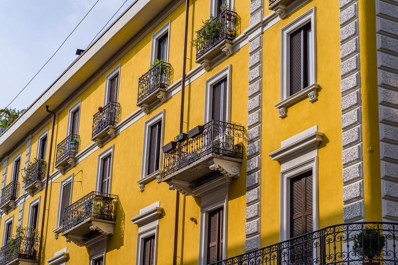 Lighting effects on egg yolk yellow building in Milan.