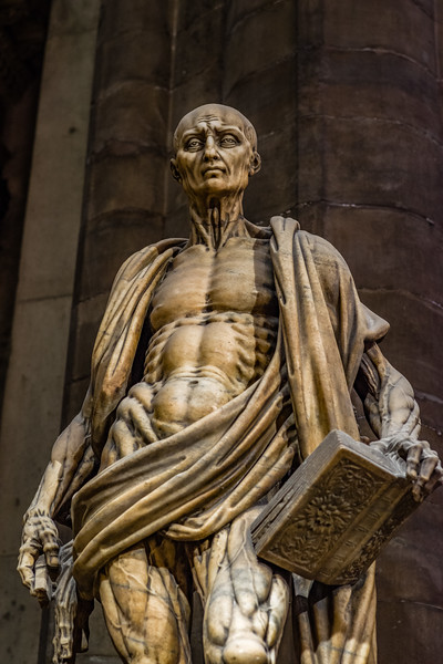 Upper detail of the statue of Saint Bartholomew in the Duomo di Milano.