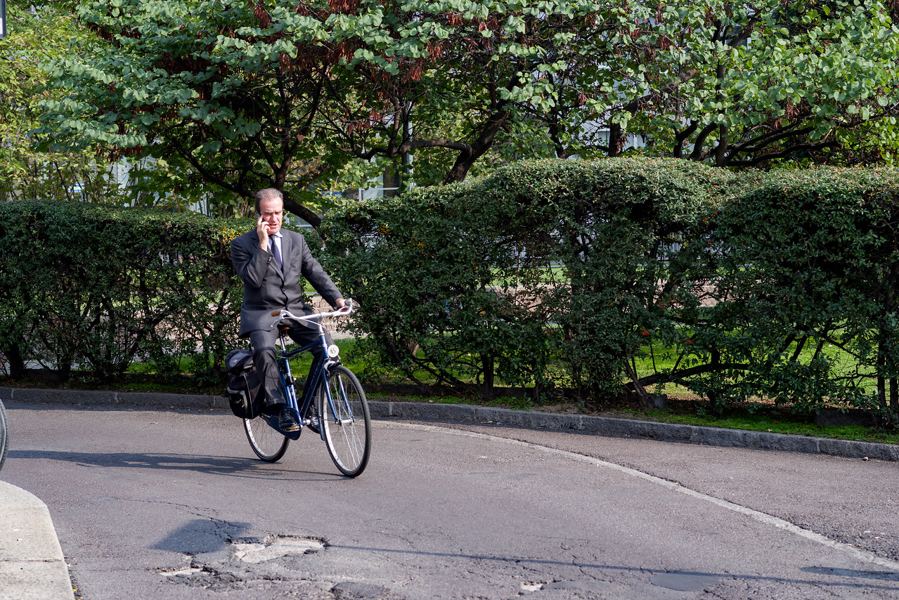 Bicyclist in business attire are a common sight in Milan.