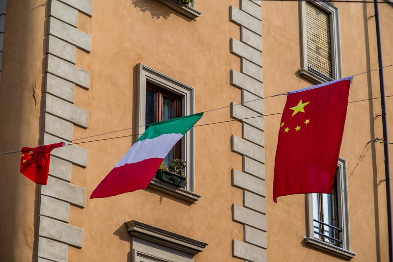 Both the Italian and the Chinese flag fly in Chinatown, a more recent district of Milan.