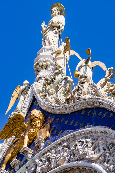 Outside detail of St. Mark with his Gospel on the west facade, top of the central pediment. The work of Niccolo di Pietro Lamberti (c. 1420).