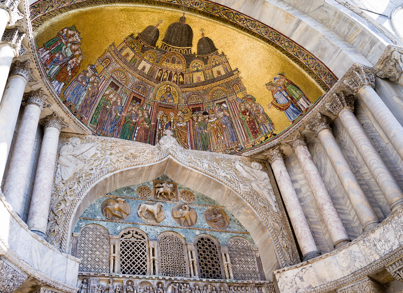 West facade of St. Mark's Basilica with the vaulted mosaic Placing the Saint's Body in the Basilica 13th century.