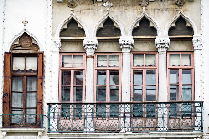 Faded pink windows, bespeaks of faded elegance from another time in Venice.