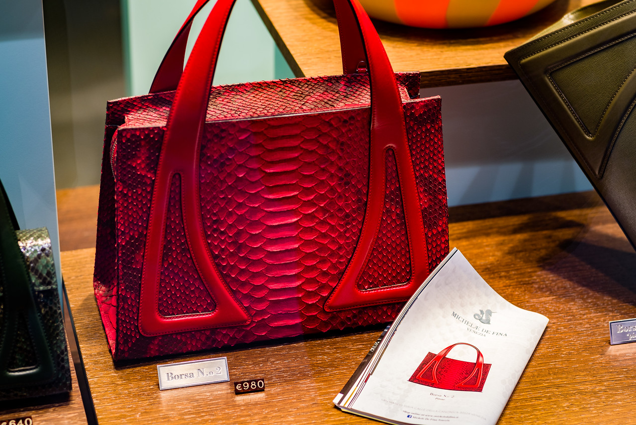 Red purse in Venice store window.