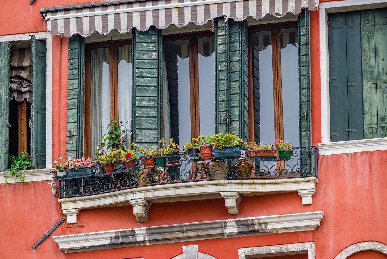 Love the persimmon colored wall with green shutters in Venice.
