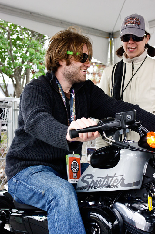 "Photographer Scott Dudelson (of JamBase) takes time to check out the latest Harley-Davidson motorcycles at ""Harley-Davidson Does SXSW"" in Austin, Texas 2010."