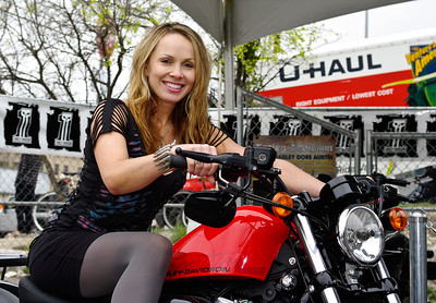 Christina Martin of RealTVfilms.com on a Harley-Davidson.