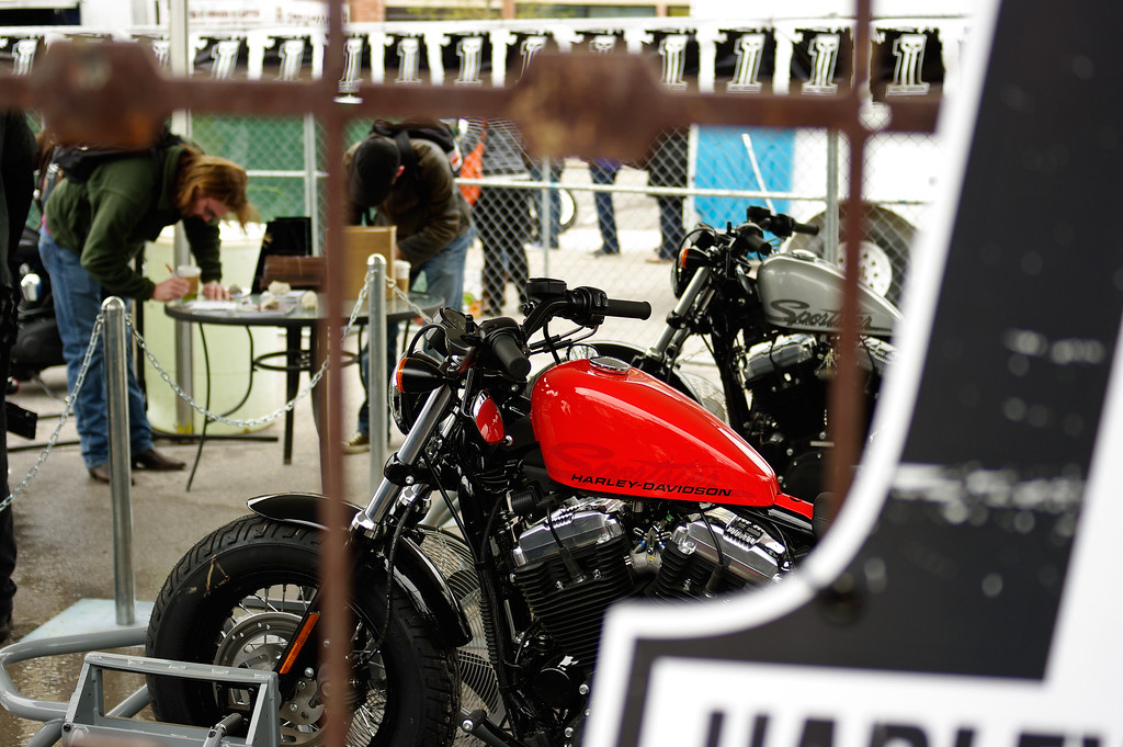 Signing up for a ride on a Harley Davidson.
